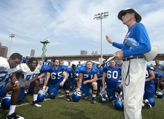 Slideshow: Fall Sports Return to Practice — Georgia State University  Head coach Bill Curry calls the team together following practice.