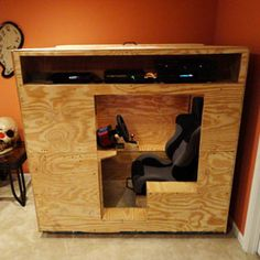 The Insane DIY Video-Game Racing Cockpit - Popular Mechanics Matt Boyer built a fully enclosed DIY cockpit complete with pedals, wheel, and shifter, in which to drive cars on Forza 4 or Gran Turismo Console Style, Wood Projects, Woodworking Projects, Diy Projects For Men, Game Room Tables, Table Games, Deco Gamer, Gaming Room Setup, Gaming Rooms