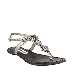 silver leather... and beautiful huge rhinestones on a t-strap sandal with a back strap... perfect... does it a exist with a bit more heel?