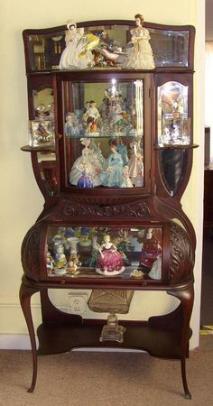 I'm pretty sure I wouldn't put dolls in the beautiful cabinet. More like Antique Glass. Mahogany Curio Cabinet - Wow!