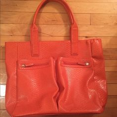 """Orange Tote Neiman Marcus Bag Neimau Marcus orange tote handbag with two zip pockets outside. Great to go out or as a beach bag. NEW WITHOUT TAG fully lined with a tonal nylon fabric inside, neiman Marcus patch inside. 100% PVC or faux leather or poly. Measures approximately 18.5""""L x 14""""H x 4.5""""D 2 straps 20""""L each Neiman Marcus Bags Totes"""