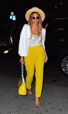 Beyonce rocks yellow trousers as Jay Z puts an affectionate hand on her back | Daily Mail Online