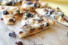 pita pizzas w/ caramelized onions, dried cherries, and gruyere cheese.    try it