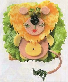 Kid-friendly open-faced lion appetizer for an ADPi legacy's birthday.  Kind of a lot of work, but if you wanted to be really lazy, you could just make a couple and use them for garnish?  #ADPi #alphadeltapi