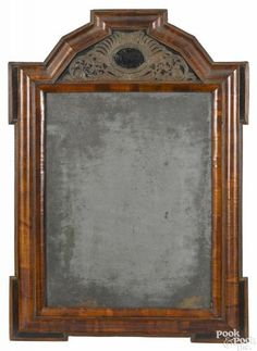 Large Dutch pillow mirror, early 18th c., the crest with an inset embossed brass plaque, 33'' x 23''.