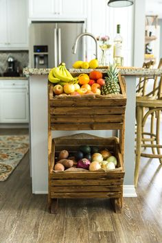 Love heading to the farmer's market? Looking for a fun way to showcase your fruits and vegetables, while saving counter space? Try building this DIY two-tier produce stand to give all your fruits and vegetables a functional, stylish home right in your kit Diy Vegetable Storage Bin, Produce Storage, Produce Stand, Fruit Storage, Produce Displays, Diy Kitchen Storage, Kitchen Organization, Kitchen Decor, Kitchen Furniture