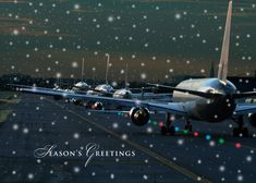 Multiple Planes Multiple planes are lined up on the runway on this aviation or airline Christmas card. A light snowfall is covering the front of this card with Season's Greetings imprinted below.