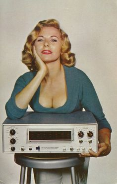"""Ridiculously over-the-top vintage stereo advertisement.  Proves the old adage that """"Sex sells."""""""