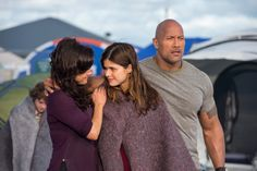 Lr CARLA GUGINO as Emma ALEXANDRA DADDARIO as Blake and DWAYNE JOHNSON as Ray in the action thriller SAN ANDREAS a production of New Line Cinema and Village Roadshow Pictures released by Warner Bros Pictures Credit Jasin Boland  2015 WARNER BROS ENTERTAINMENT INC WV FILMS IV LLC AND RATPACDUNE ENTERTAINMENT LLC  US CANADA BAHAMAS  BERMUDA  2015 VILLAGE ROADHSOW FILMS BVI LIMITED WARNER BROS ENTERTAINMENT INC AND RATPACDUNE ENTERTAINMENT LLC  ALL OTHER TERRITORIES
