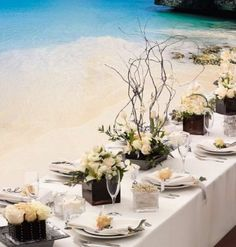 Very chic beach table setting.