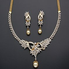 18 carat yellow gold intricate simple yet elegant diamond short necklace with round and rose cut diamonds adorned all over, leafy design . Diamond Necklace Set, Diamond Pendant, Diamond Jewelry, Dimond Necklace, Gold Jewelry, Indian Wedding Jewelry, Indian Jewelry, Bridal Jewelry, Indian Jewellery Design