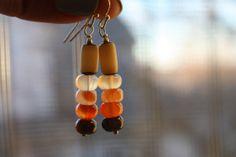 jellybean earrings by dreamofkashmir on Etsy, $12.00 #carnelian #bone #crystal #healing #stone #orange #red #mod #wirewrapped #handmade #OOAK #earrings