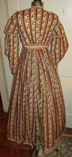 "Pre Civil War Era Roller Print Cotton Dress with Strong Colors Paisley Pattern | eBay seller antiquechoc; hand sewn, bodice is lined, pleated skirt, measurements laid flat: armpit to armpit: 16""; shoulder to hem: 50.5""; waist: 13""."