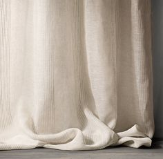 RH's Pinstripe Sheer Belgian Linen Drapery:Refined pinstripes accent our 100% Belgian linen drapery, offering sheer, lightweight coverage and rich texture woven from the world's finest Belgian flax. The linen is loomed at Libeco-Lagae, Belgium's oldest and most venerable mill.