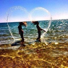 Flip your hair like the secret mermaids that you are. | 37 Impossibly Fun Best Friend Photography Ideas-- We've done some, but we need to try this one lol