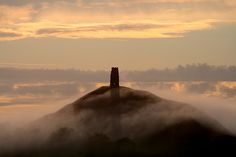 The real mists of Avalon. Well, that is if you believe Glastonbury Tor is Avalon. Mists Of Avalon, Medieval, Glastonbury Tor, Somerset England, Beautiful World, Great Places, Architecture, Places To Travel, Countryside