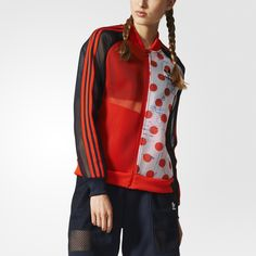 This women's track jacket takes archival looks to the cutting edge, blending history with modern street-ready style. It flashes bold solid colors, pairing them with a polka-dot print inspired by a vintage '70s poster design. Finished with an all-mesh build and ribbing at the cuffs and hem.