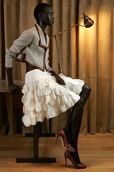 playful skirt + serious jacket on Alek Wek