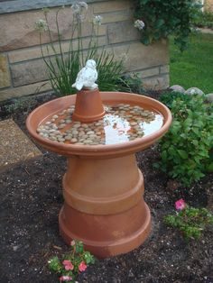 Easy and inexpensive birdbath, I try to put one of these in my garden each year. Easy to store also, just take apart.