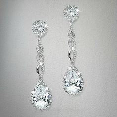 These wedding earrings by LucyAlia have haute couture styling with fiery pear-shaped cubic zirconia drops plated in silver rhodium