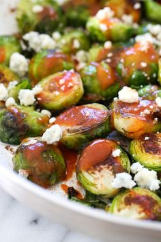 These Brussels sprouts start out in the skillet and get finished in the oven for perfectly charred edges, then they are drizzled with hot sauce and crumbled blue cheese – SO good!!