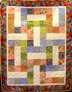 A serene quilt of calicos and roses.