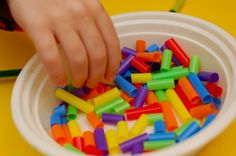 fine motor practice - beading with cut up straws