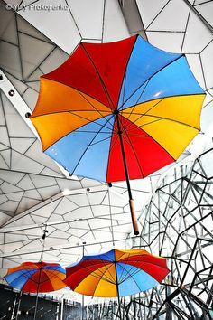 Umbrellas  The Atrium, Federation Square, Melbourne Victoria Australia.  by Yury Prokopenko