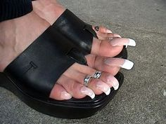 WHY R HER TOENAILS  SO LONG AND UGLY?  Do they really think they are pretty?  They are ugly, ugly.