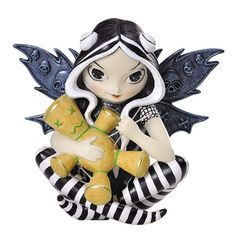 VooDoo is part of the Strangeling Fairy Collection from Jasmine Becket Griffith. The VooDoo Fairy Figurine is a unique little fairy with wide eyes, petite forms, and delicate wings. Jasmine Becket Gri