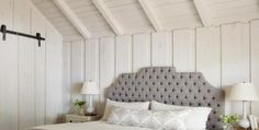 Tongue and groove ceiling, board and batten, upholstered headboard and bed frame, white bedding