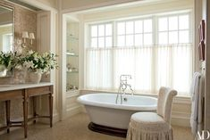 A Kohler tub with Rohl fittings occupies the master bath the Gomezdesigned slipper chair is from the Shop