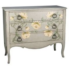 "Chest with painted floral motif and drop pulls.  Product: ChestConstruction Material: WoodColor: GrayFeatures: Three drawersDimensions: 40"" H x 36"" W x 16"" D"