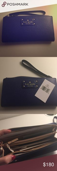 Kate Spade Wellesley Layton in Emperoble Kate Spade Wellesley Layton in Emperoble very cute tech friendly wristlet still new with tags! This clutch has just been sitting in my closet I have not used it once and it's adorable but it's too big for me! You can most likely fit a smartphone in here! It has 12 card slots a coin zip pocket in the middle two bill bifolds and another zip pocket at the front and a slip in pocket at the back! I feel like this item is a gem but I don't like clutches…