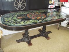 This is a vintage iron table with a light up stained glass top that sits beneath plate glass.  It's incredible!  It's for sale at Picker's Playground!  110 East Union Street, Waupaca, WI  54981