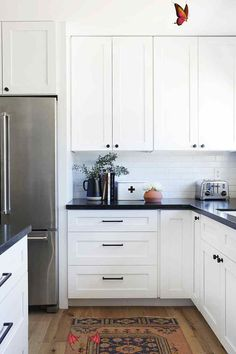 How an Interior Designer Made Her First Home Her Own How an Interior Designer Made Her First Home Her Own | Rue<br> New Kitchen Cabinets, Kitchen Paint, Kitchen Countertops, Soapstone Kitchen, Island Kitchen, Ikea Kitchen, Long Kitchen, White Cabinets, Laminate Countertops