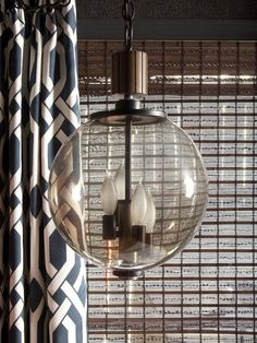 Smoked Glass Pendant >> http://www.hgtvremodels.com/interiors/pet-friendly-basement-inspires/index.html?soc=pinterest