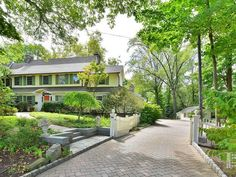Recently sold: $1,099,000. Set on two acres, this 1920 home has been brought into the 21st century with style and grace. Architectural details of the original home combine with a stunning addition that includes a sun-filled, glass-enclosed loggia with radiant heat floors and French doors that open to the living room as well as to the lush, landscaped gardens and expansive bluestone patio. A two-story library, inspired by the one in Thomas Edison's home in nearby Llewellyn Park, is anothe...