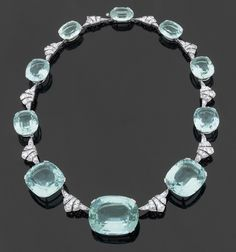 Spectacular Art Deco necklace in geometric patterns platinum set with diamonds alternating ten large cuchion cut aquamarines with a total weight of 280 carats, circa 1925.