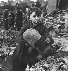 Little boy with his elephant toy after an air-raid bombing on London during WW2