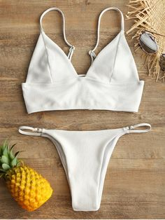 You'll look special at the beach or by the pool with this ribbed texture bikini. Features adjusted cami shoulder straps and crisscrossed lace up at the back for a perfect fit, a solid color design and padded cups for swim bra. Matching V-sting swim bottoms will flatter your curves with its minimal coverage over the buttocks. #Zaful #Swimwear #Bikini