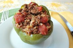 Stuffed Peppers - A traditional stuffed pepper made with ground beef, tomatoes, rice, onions and peppers and then baked