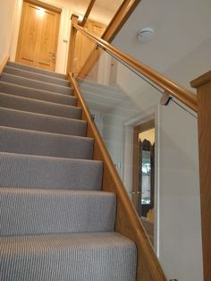 Glass balustrade to an oak staircase grey carpet Carpet Staircase, House Staircase, Staircase Railings, Staircase Design, Staircases, Staircase Ideas, Bannister Ideas, Glass Bannister, Stair Handrail