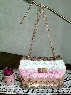 The crocheted cord bag with the gold accessories. To order this bag write me direct.