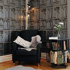 Ex Libris is a very popular Fornasetti wallpaper featuring beautifully etched books in a trompe l'oeil library shelf pattern.  It is demure and unusual, and creates an almost 3D visual.