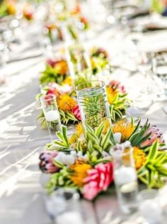 Mini pineapples in water? Wedding Reception Photos by Michelle Garibay Events