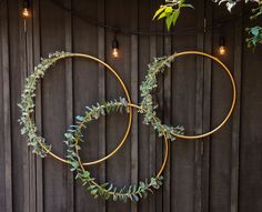Greenery Hoops - Gold spray painted hula hoops with greenery attached created a beautiful backdrop at an event Bridal Shower Backdrop, Diy Backdrop, Backdrops, Wedding Wall Decorations, Floral Hoops, Hula Hoop, Real Flowers, Paper Flowers, Wedding Blog