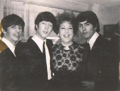 """Ringo, John and George posing with Ethel Merman for a photo at """"Alma Cogan's Party 44 Stafford Court London, England Sunday - Feb, 23/64″ - as written on the back of this picture, belonging to Ethel Merman herself. The Beatles had just returned to..."""