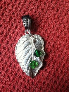 Raspberry leaf painted with art clay silver.