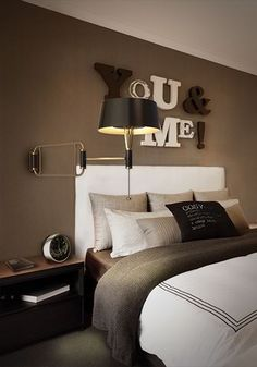 "I chose this bedroom because of the personal feel it gives. Adding those words "" You & Me ! "" on the wall makes anyone imagine that it's intended for them and their beloved one. The colour scheme is very warm. The wall having a dark colour instead of white helps advance the bed in a room, visually."
